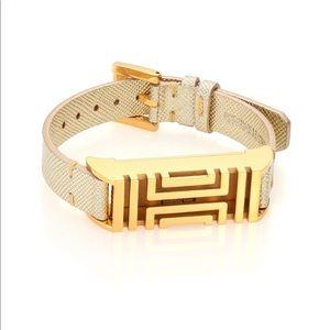 Gold Tory Burch Fitbit bracelet tracker!